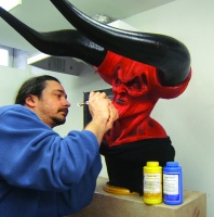 "David Pea puts the finishing touches on the ""Darkness"" Mask Dragon Skin with Psycho Paint The mask has a FlexFoam-It™ 5 core. Horns cast in Task™ plastic shell filled with rigid Foam-It™ 3."